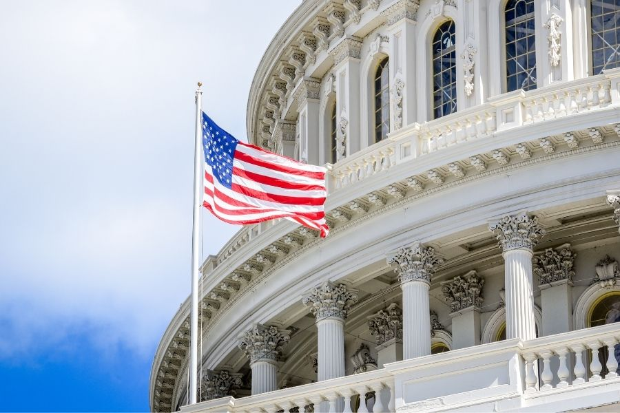 American flag in front of capital building